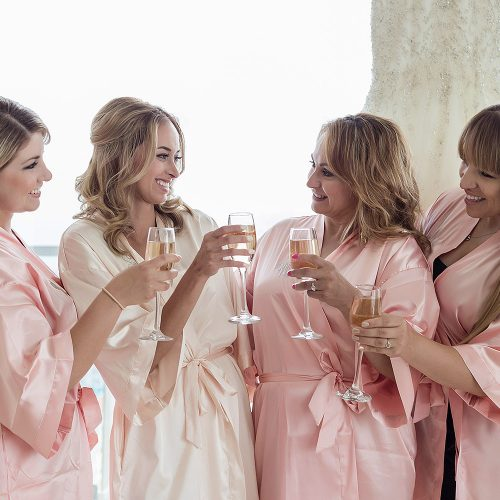 Bridesmaids wearing robes before wedding