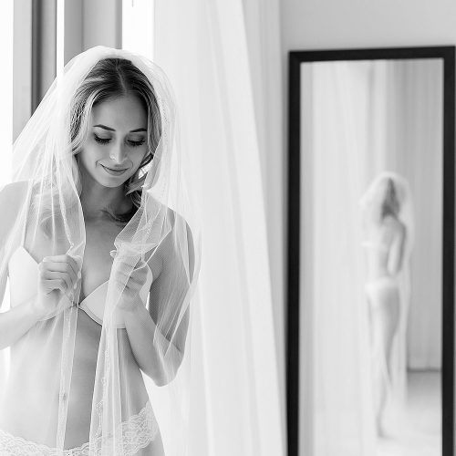Intimate photograph of bride before wedding at Secrets on the Vine in Cancun