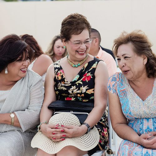 Guests laughing before wedding.