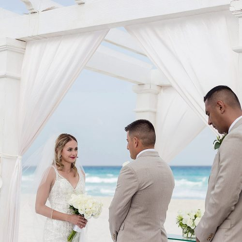 Wedding ceremony on beach at Secrets on the Vine in Cancun