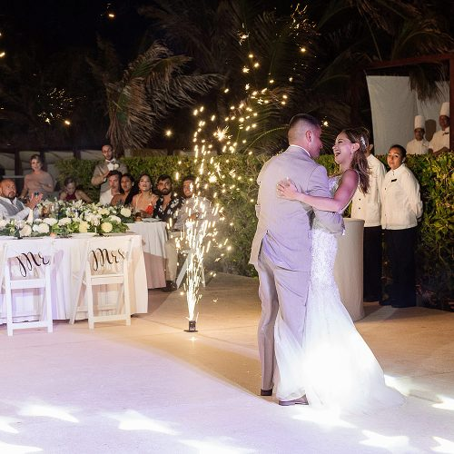 Bride and groom dancing when fireworks go off during first dance at Secrets on the Vine in Cancun