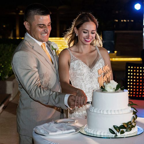Bride and groom cutting cake at cancun weddding