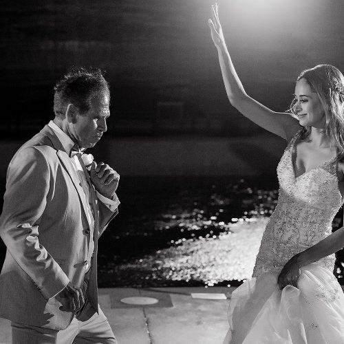 Bride and guest dancing on dance floor.