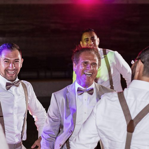 Guest dancing on dance floor at wedding in Cancun