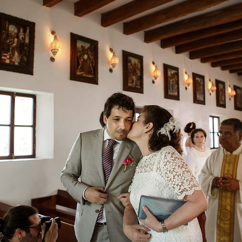 Groom and mother at wedding ceremony