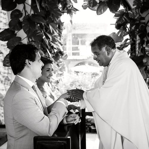 Bride and groom receiving mass at wedding ceremony