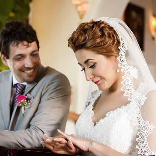 Bride looking at ring at wedding ceremony in Riviera Maya