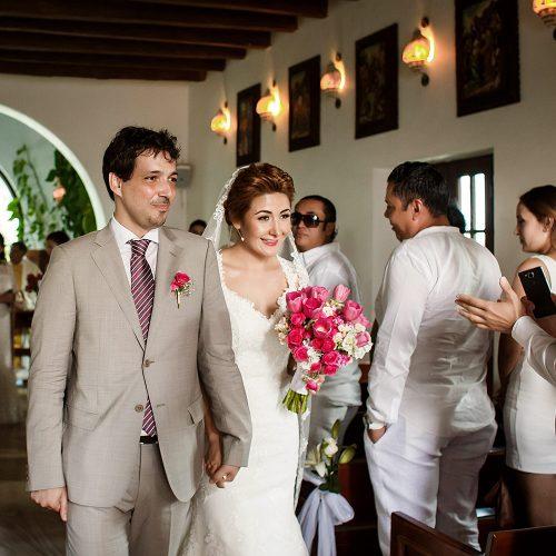 Bride and groom walking after wedding ceremony