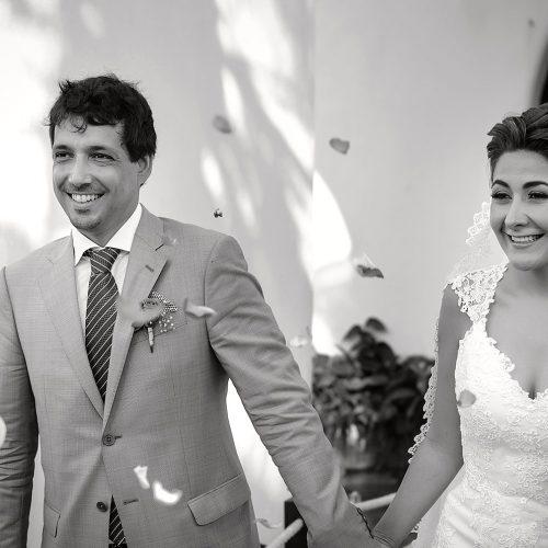 Bride and groom walking after wedding ceremony in Riviera Maya