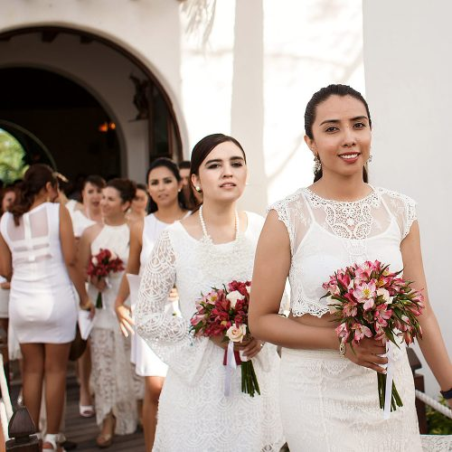 Bridal party walking out of church in Riviera Maya