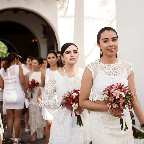 Bridal party walking out of church in Riviera Maya