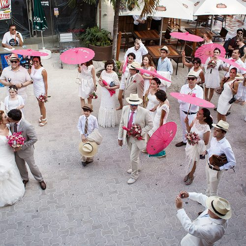 Bride and groom with mariachi band on streets in Riviera Maya
