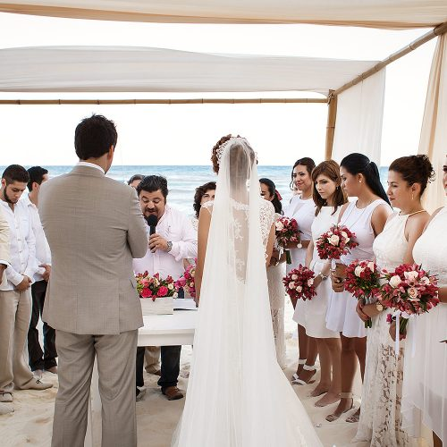 Bride and groom signing documents at wedding in Riviera Maya