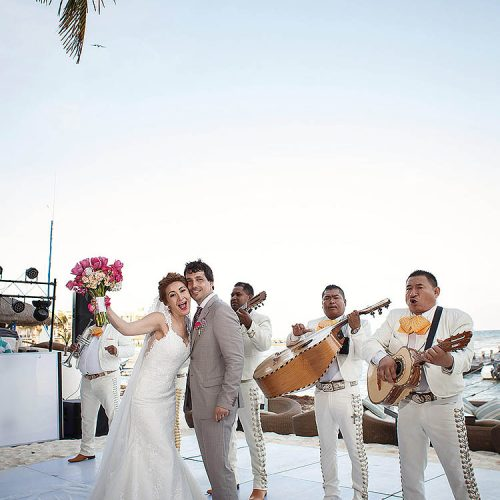 Bride and groom on dance floor with mariachi band in Riviera Maya