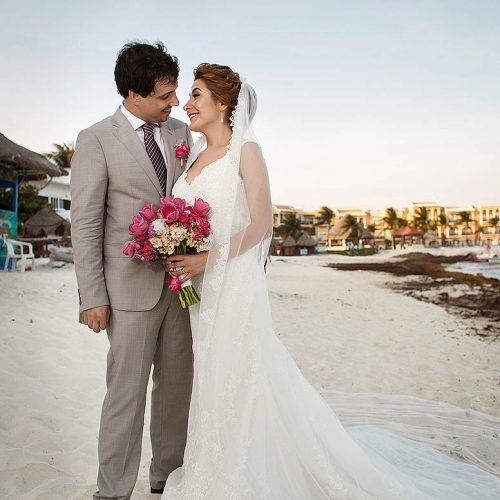 Bride and groom on beach in Riviera Maya