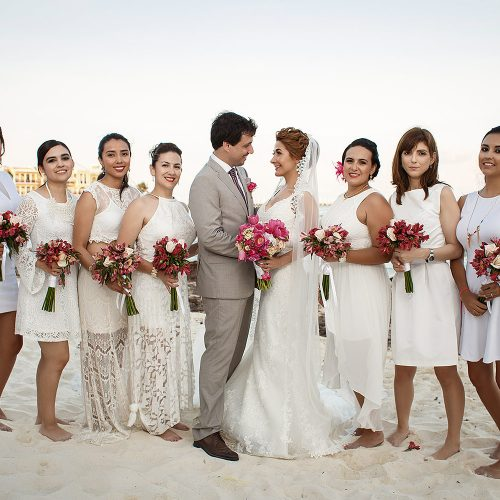 Bride and groom with bridal party on beach in Riviera Maya