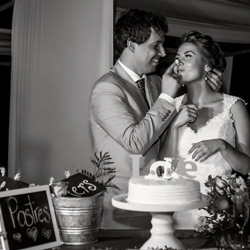 Groom feeding cake to bride at wedding