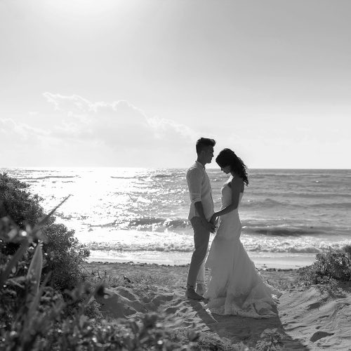 Bride and groom with Mexican Caribbean behind them.
