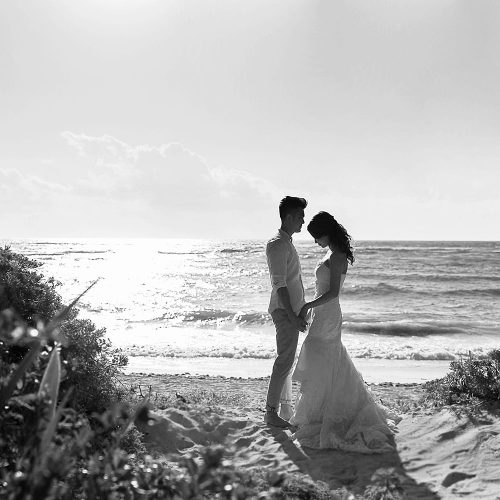 Silhouette of bride and groom on beach