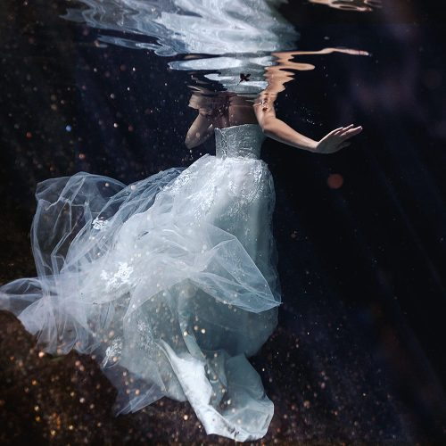 Bride's wearing dress in underwater shooting Mayan Cenote