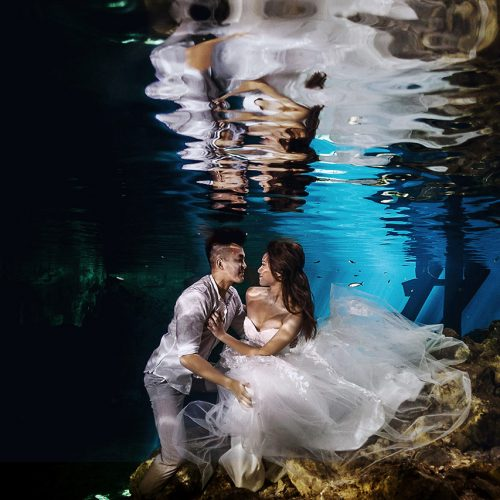 Bride and groom under water in Trash the Dress