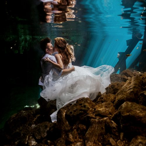 Bride and groom from behind at Cenote Trash the Dress (TTD) in Mexico