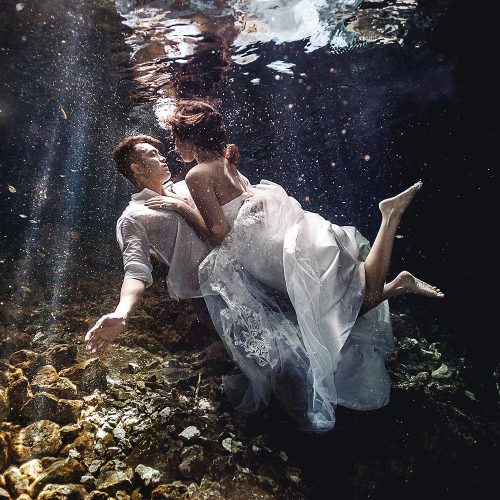 Bride and Groom underwater