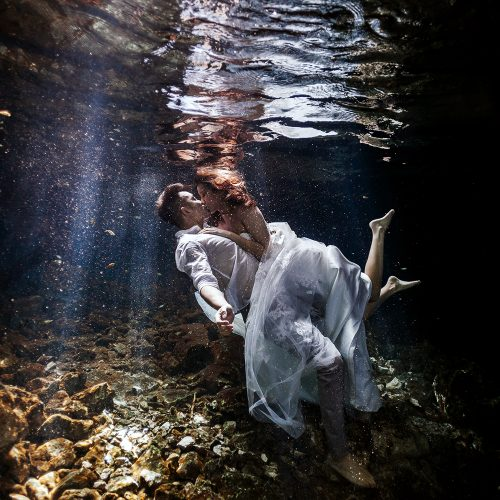 Bride and Groom in Cenote Trash the Dress (TTD) in Mexico