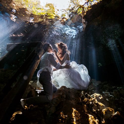 Bride and groom underwater in Cenote Trash the Dress (TTD) in Mexico