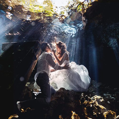 Bride and groom in Cenote underwater in Trash the Dress session