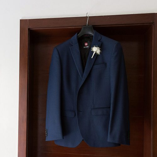 Groom jacket hanging on door