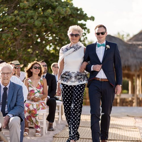 Groom walking down aisle with mother at Punta Venado, Riviera Maya Mexico