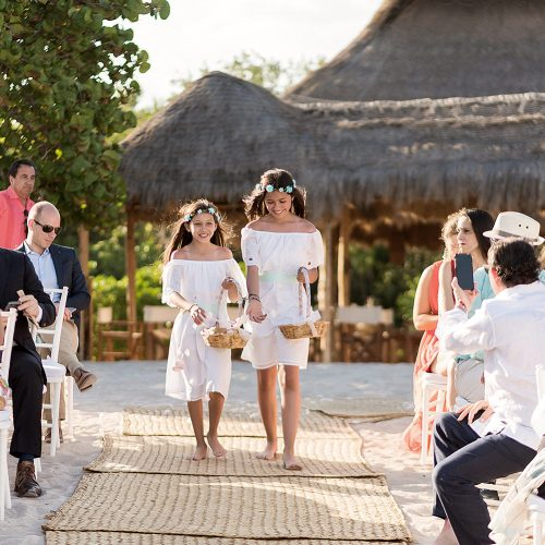 Flower girls on aisle at wedding at Punta Venado, Riviera Maya Mexico