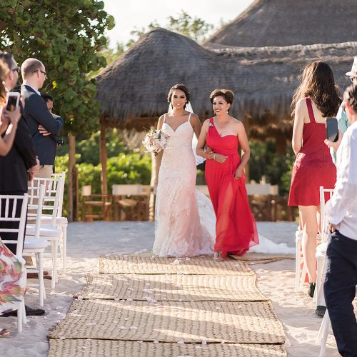 Bride walking down aisle with mother at Punta Venado, Riviera Maya Mexico