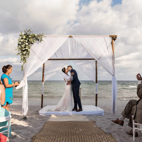 Bride and grooms first kiss during ceremony at Punta Venado, Riviera Maya Mexico