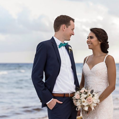 Bride and groom on beach at Punta Venado, Riviera Maya Mexico