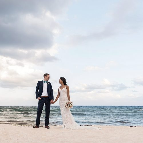 Bride and groom holding hands on beach at Punta Venado, Riviera Maya Mexico