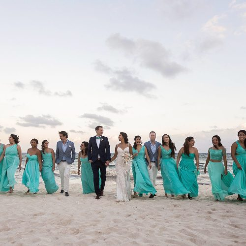 Bridal party walking on beach at Punta Venado, Riviera Maya Mexico