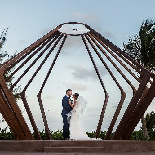 Bride and groom in gazebo at Azul Fives Riviera Maya