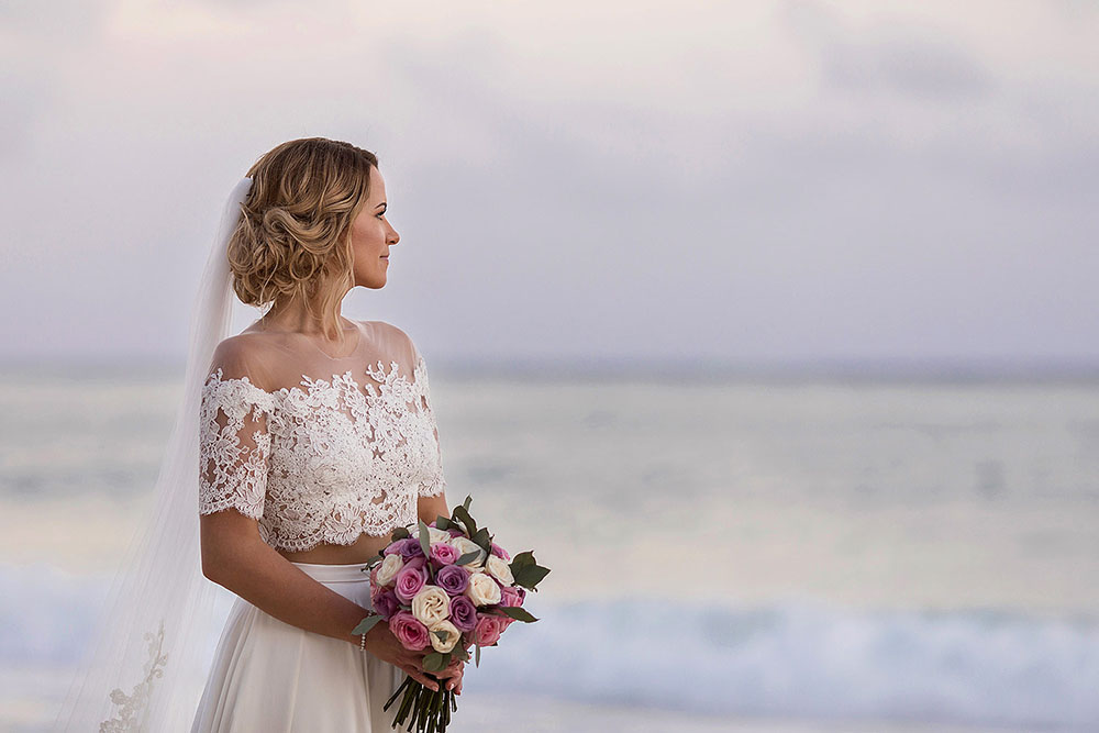 Bride with perfect hair on beach in Cancun