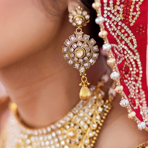 Close up of Indian brides ear ring at wedding
