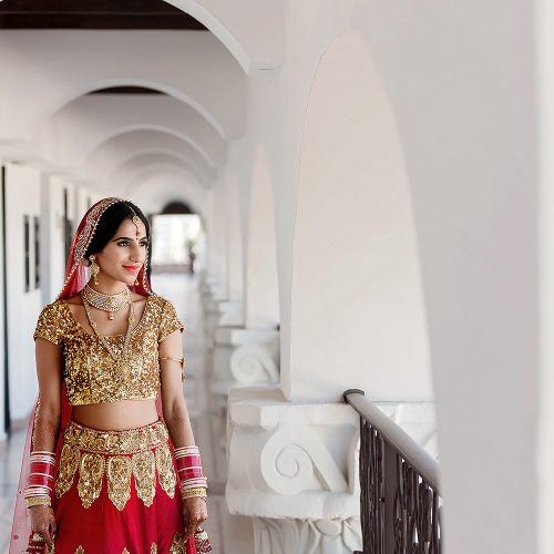 Indian bride walking in hallway in Cancun