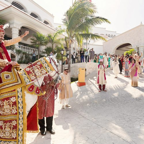 Baraat wedding ceremony with groom on horse in Cancun
