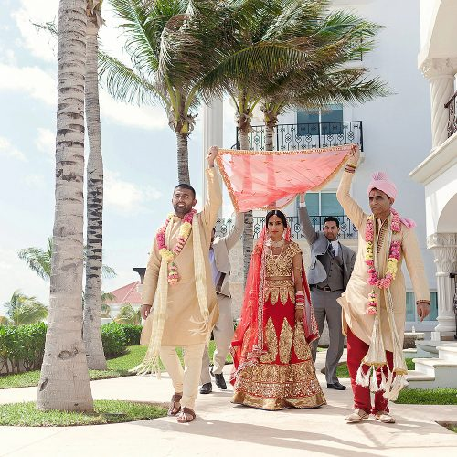 Indian bride being brought to the wedding ceremony in Cancun