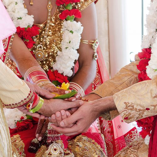Close up of hands during Indian wedding ceremony
