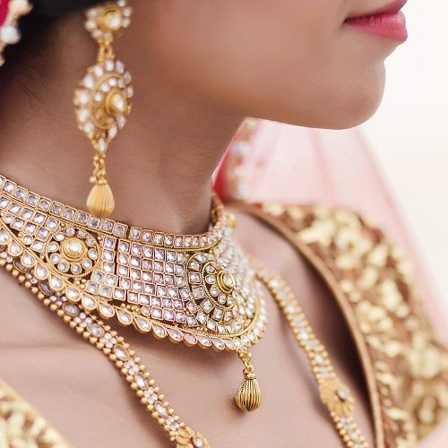 Close up of brides necklace and jewlery.
