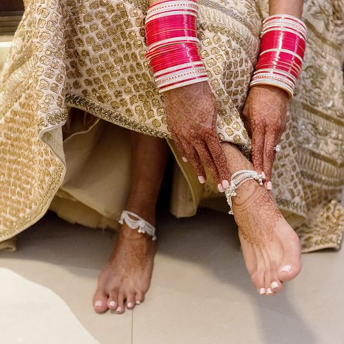 Close up of bride's feet at getting ready for wedding reception