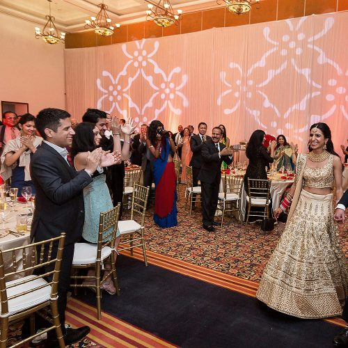Bride and groom arriving to Indian wedding reception in Cancun