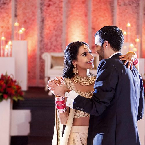 Bride and grooms first dance at Indian wedding reception