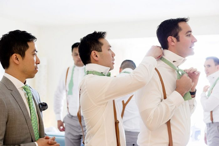 Groomsmen getting ready for wedding a Finest Resort in Playa Mujeres Cancun